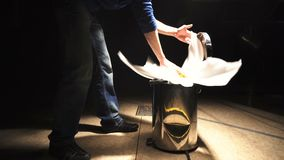 Man throws a flower into the trash can. Theatrical scenery stock video