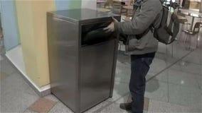 Man throws food in trash stock video footage