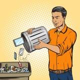 Man throws gadget device into trash pop art vector Stock Photography