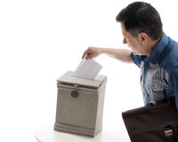 Man throws a letter in the mailbox Stock Image