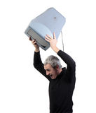 Man throws old TV. On white background Royalty Free Stock Image