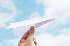 Man throws a paper plane to sky Royalty Free Stock Images