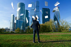 Man throws paper sheets. The person throws standard sheets in the afternoon Stock Image