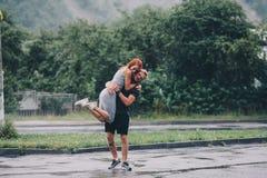 Man throws up his girlfriend Royalty Free Stock Photos