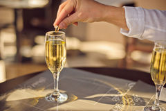 Man throws wedding ring in glass of champagne Royalty Free Stock Images