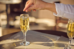 Man throws wedding ring in glass of champagne Royalty Free Stock Photography