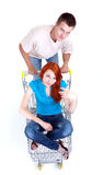 Man thrusting shop trolley with woman Stock Images