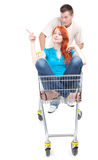 Man thrusting shop trolley, woman pointing Royalty Free Stock Images