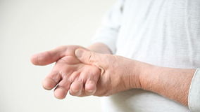 Man with thumb pain Stock Images