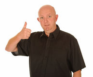 Man with thumb up. Bald middle aged man gesturing with thumb up, white studio background Stock Photography