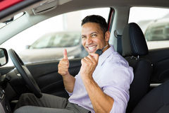 Man thumb up new car Stock Images