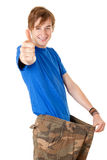 Man with thumb up showing how much weight he lost Stock Images