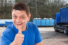 Man with thumbs up in front of a recycling-forwarding Royalty Free Stock Photo