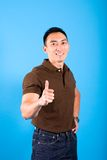Man with thumbs up gesture signifying everything i Royalty Free Stock Photography