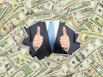 A man with thumbs up inside the US Dollar bills frame. All nominal bills both sides. Royalty Free Stock Photos
