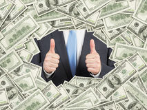 A man with thumbs up inside the US Dollar bills frame. 100 dollar nominal bills both sides. Stock Photos