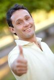 Man with thumbs up outdoors Stock Photos