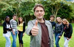 Man with thumbs up outdoors Royalty Free Stock Images