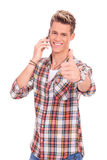Man with thumbs up while on the phone Royalty Free Stock Photo