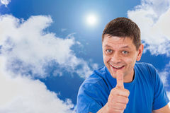 Man with thumbs up and sunny sky Stock Photos