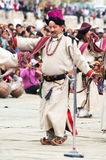 Man in Tibetan clothes performing folk dance Royalty Free Stock Photo