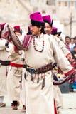 Man in Tibetan clothes performing folk dance Stock Photo