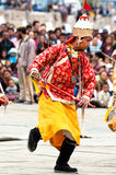 Man in Tibetan clothes performing folk dance Stock Images