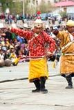 Man in Tibetan clothes performing folk dance Royalty Free Stock Image