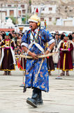 Man in Tibetan clothes performing folk dance Stock Image