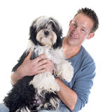 Man and  tibetan terrier Stock Photo