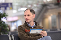 Man with ticket Royalty Free Stock Photo