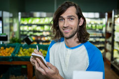 Man ticking on shopping checklist Stock Image