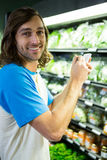Man ticking on shopping checklist Stock Images