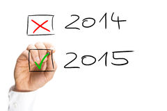 Man ticking the start of the 2015 New Year Stock Photo