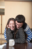 Man tickles the laughing woman Stock Photo