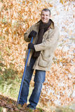 Man tidying autumn leaves Royalty Free Stock Image