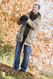 Man tidying leaves in garden Royalty Free Stock Images
