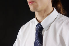Man in tie and collared shirt. Close-up of a white shirt and tie Stock Image