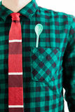 Man with tie and a green spoon in the pocket Royalty Free Stock Photos