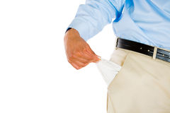 Man with tie, khakis, dress shirt, and belt, pulling out empty pocket Stock Photos