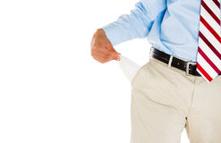 Man with tie, khakis, dress shirt, and belt, pulling out empty pocket Royalty Free Stock Image