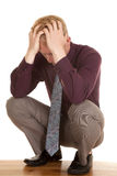 Man in tie purple shirt depressed hands on head Stock Photos