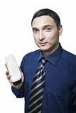 Man in tie with shampoo bottle Royalty Free Stock Photography