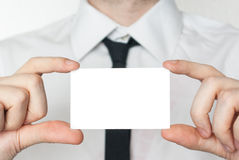 Man in tie showing and holding a card Stock Image