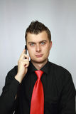 Man in a tie speaks on phone Royalty Free Stock Photography