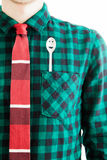 Man with tie and a spoon in the pocket Royalty Free Stock Images