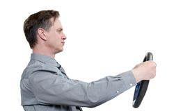 Man in tie with a steering wheel, side view, isolated on white background. Car drive concept.  Stock Photography