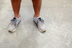 Man tying running shoes. The man tied his shoelaces. Standing on a concrete floor Royalty Free Stock Photography