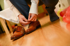 Man tied shoelace Stock Photography