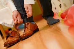 Man tied shoelace Royalty Free Stock Image